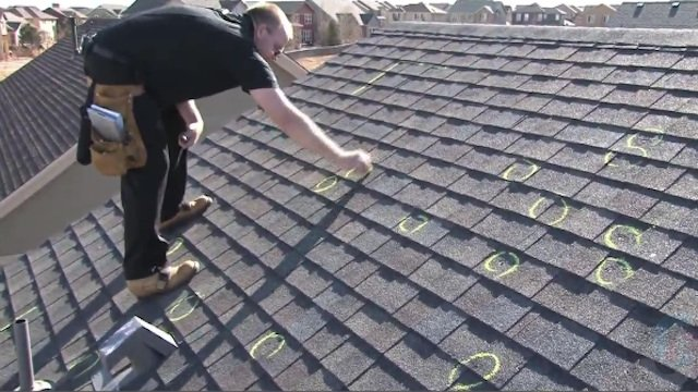 Roof inspection after hail storm.
