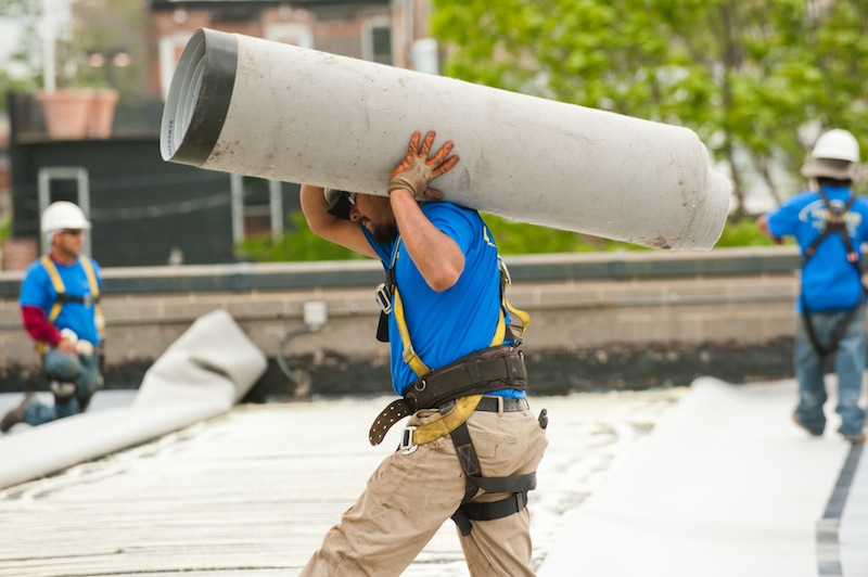 roofers working on a flat commercial roof | St. Louis, MO