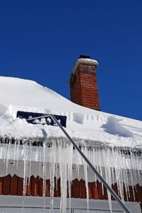 Use a roof rake to remove snow from roof.
