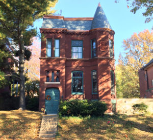Built in 1886, a beautiful new scalloped slate roof adorns this home in a historic St. Louis neighborhood.